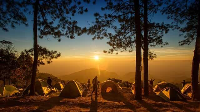 camping in national park, tents sunset sky trees mountain